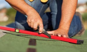 Kitchener Affordable Roofing employee replacing shingles