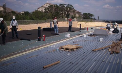 Kitchener Affordable Roofing flat roof workers