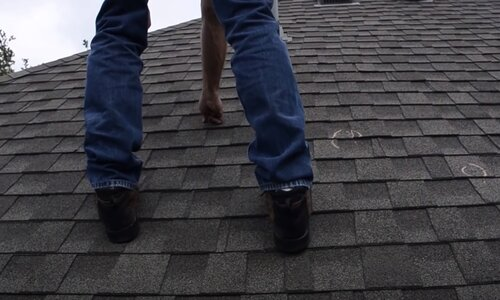 Kitchener Affordable Roofing worker doing a roof inspection